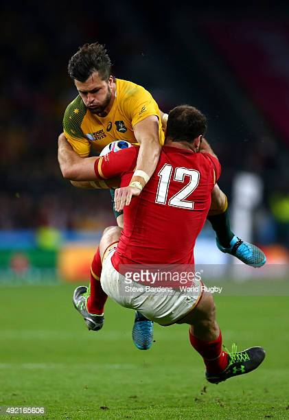 Adam AshleyCooper of Australia is tackled by Jamie Roberts of Wales during the 2015 Rugby World Cup Pool A match between Australia and Wales at...