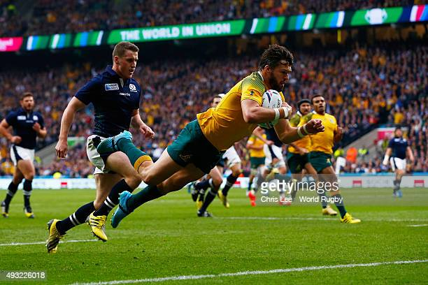 Adam AshleyCooper of Australia scores his teams opening try during the 2015 Rugby World Cup Quarter Final match between Australia and Scotland at...