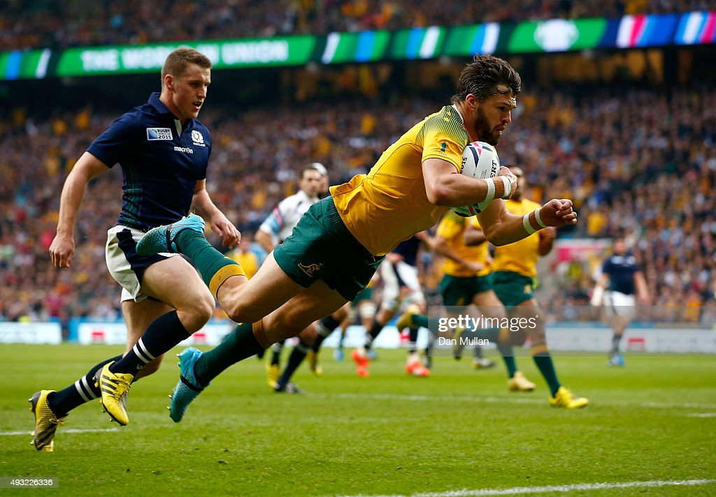<a gi-track='captionPersonalityLinkClicked' href=/galleries/search?phrase=Adam+Ashley-Cooper&family=editorial&specificpeople=637621 ng-click='$event.stopPropagation()'>Adam Ashley-Cooper</a> of Australia scores his teams opening try during the 2015 Rugby World Cup Quarter Final match between Australia and Scotland at Twickenham Stadium on October 18, 2015 in London, United Kingdom.
