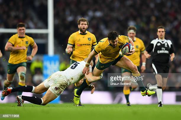 Adam AshleyCooper of Australia tries to escape the tackle of Mike Brown of England during the QBE international match between England and Australia...