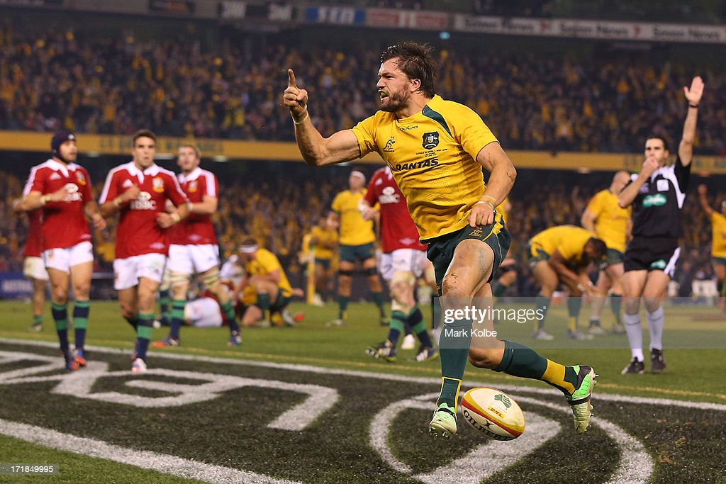 <a gi-track='captionPersonalityLinkClicked' href=/galleries/search?phrase=Adam+Ashley-Cooper&family=editorial&specificpeople=637621 ng-click='$event.stopPropagation()'>Adam Ashley-Cooper</a> of the Wallabies celebrates scoring a try during game two of the International Test Series between the Australian Wallabies and the British & Irish Lions at Etihad Stadium on June 29, 2013 in Melbourne, Australia.