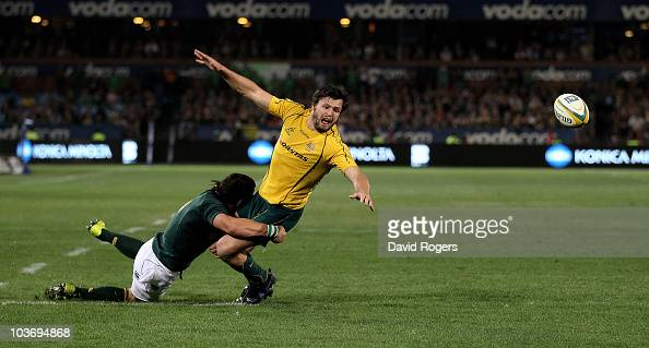 Adam AshleyCooper of the Wallabies drops the ball just short of the line as Francois Hougaard tackles during the 2010 TriNations match between the...