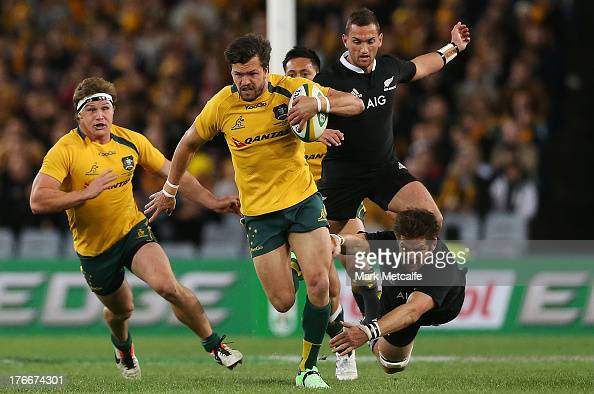 Adam AshleyCooper of the Wallabies evades the tackles of Richie McCaw and Aaron Cruden of the All Blacks during The Rugby Championship Bledisloe Cup...