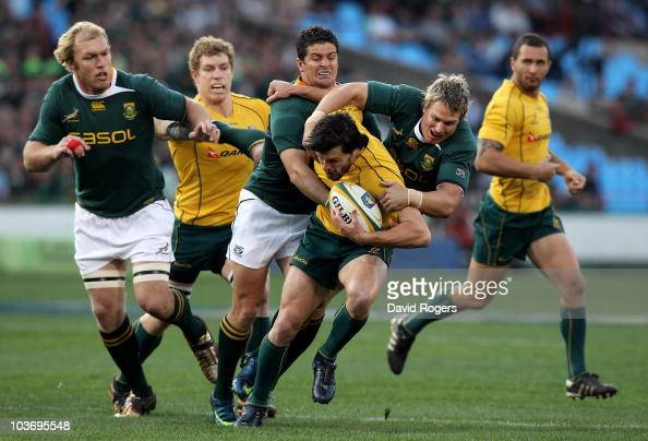 Adam AshleyCooper of the Wallabies is tackled by Jean de Villiers and Morne Steyn during the 2010 TriNations match between the South African...