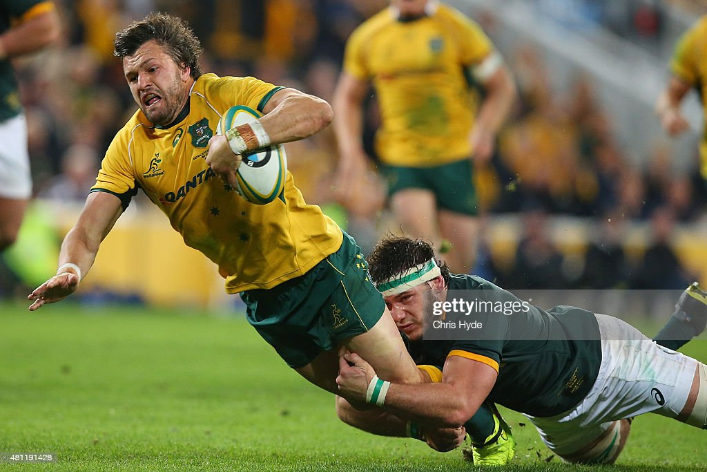 <a gi-track='captionPersonalityLinkClicked' href=/galleries/search?phrase=Adam+Ashley-Cooper&family=editorial&specificpeople=637621 ng-click='$event.stopPropagation()'>Adam Ashley-Cooper</a> of the Wallabies makes a break to score a try during The Rugby Championship match between the Australian Wallabies and the South Africa Springboks at Suncorp Stadium on July 18, 2015 in Brisbane, Australia.