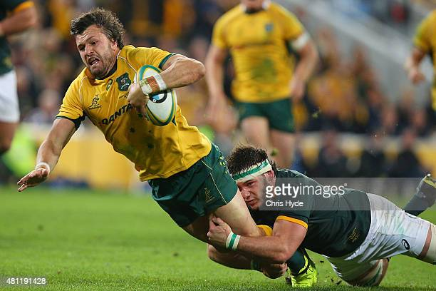 Adam AshleyCooper of the Wallabies makes a break to score a try during The Rugby Championship match between the Australian Wallabies and the South...