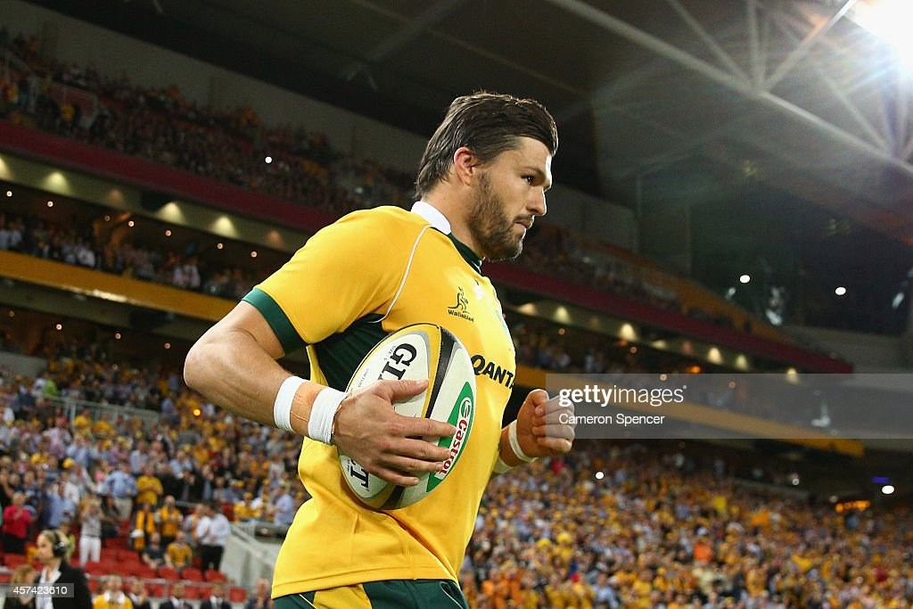 <a gi-track='captionPersonalityLinkClicked' href=/galleries/search?phrase=Adam+Ashley-Cooper&family=editorial&specificpeople=637621 ng-click='$event.stopPropagation()'>Adam Ashley-Cooper</a> of the Wallabies runs out onto the field for his 100th test during The Rugby Championship match between the Australian Wallabies and the New Zealand All Blacks at Suncorp Stadium on October 18, 2014 in Brisbane, Australia.
