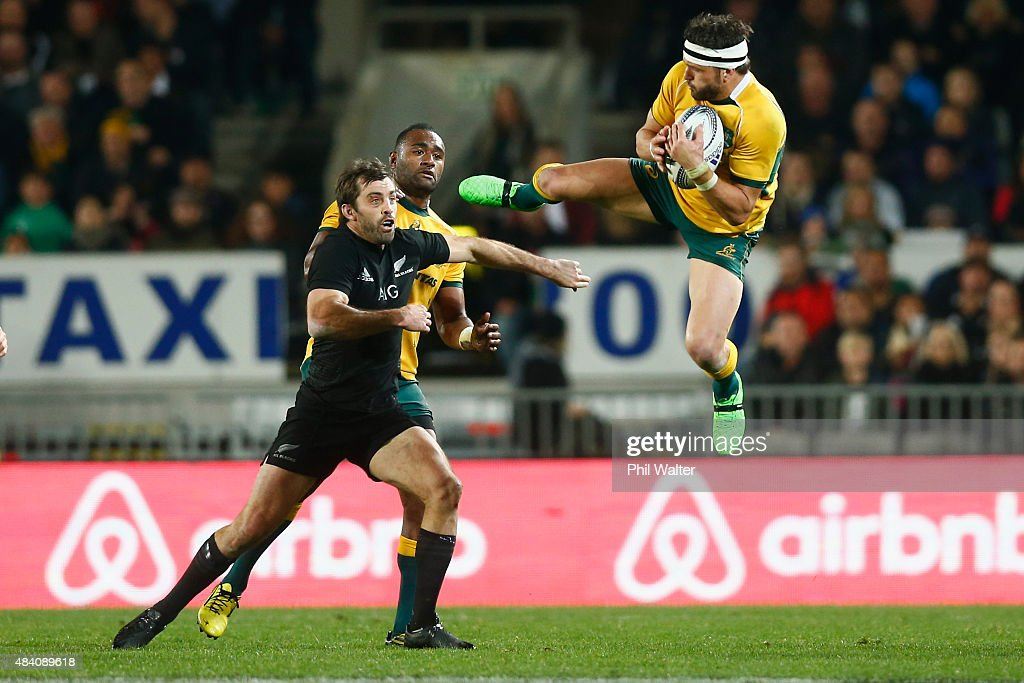 Adam Ashley-Cooper of the Wallabies takes a high ball under pressure from Conrad Smith of the All Blacks during The Rugby Championship, Bledisloe Cup match between the New Zealand All Blacks and the Australian Wallabies at Eden Park on August 15, 2015 in Auckland, New Zealand.
