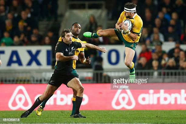 Adam AshleyCooper of the Wallabies takes a high ball under pressure from Conrad Smith of the All Blacks during The Rugby Championship Bledisloe Cup...