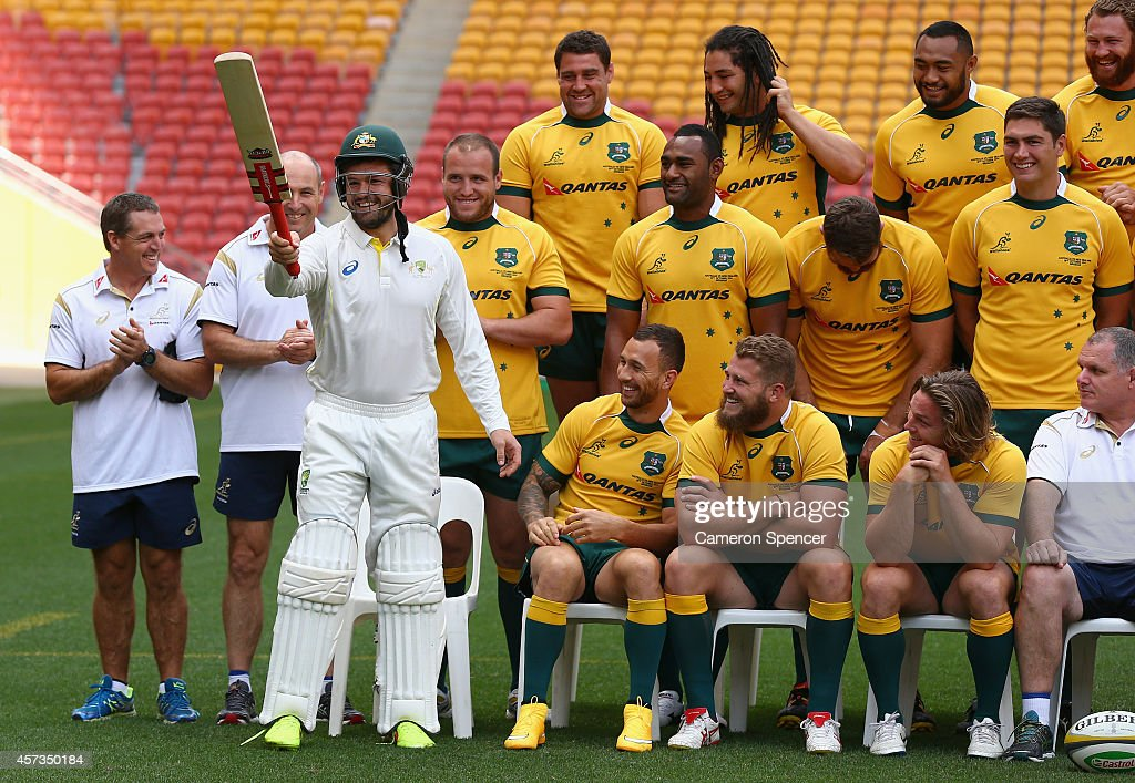 <a gi-track='captionPersonalityLinkClicked' href=/galleries/search?phrase=Adam+Ashley-Cooper&family=editorial&specificpeople=637621 ng-click='$event.stopPropagation()'>Adam Ashley-Cooper</a> of the Wallabies walks onto the field in cricket whites celebrating his upcoming 100th test for the Wallabies during an Australian Wallabies Captain's Run at Suncorp Stadium on October 17, 2014 in Brisbane, Australia.
