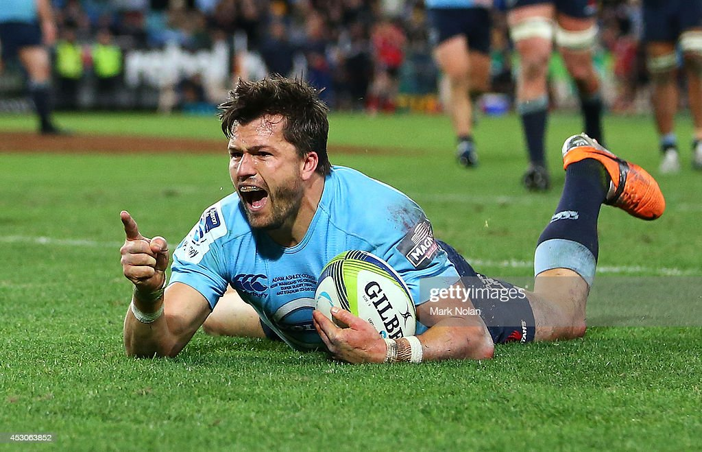 Adam AshleyCooper of the Waratahs celebrates scoring a try during the Super Rugby Grand Final match between the Waratahs and the Crusaders at ANZ...