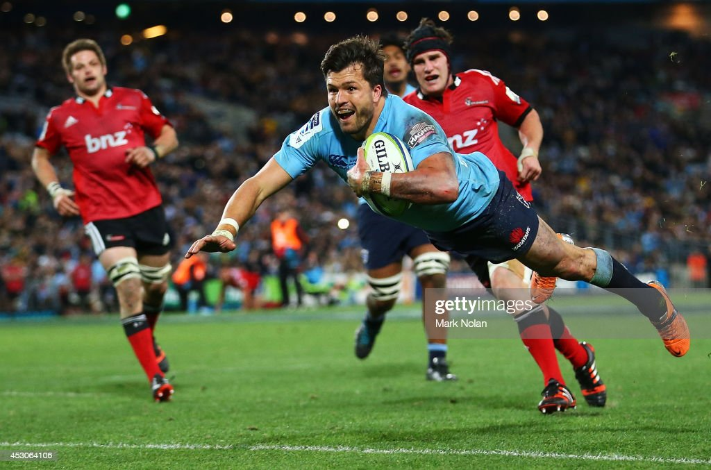 <a gi-track='captionPersonalityLinkClicked' href=/galleries/search?phrase=Adam+Ashley-Cooper&family=editorial&specificpeople=637621 ng-click='$event.stopPropagation()'>Adam Ashley-Cooper</a> of the Waratahs dives to score a try during the Super Rugby Grand Final match between the Waratahs and the Crusaders at ANZ Stadium on August 2, 2014 in Sydney, Australia.