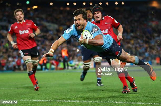 Adam AshleyCooper of the Waratahs dives to score a try during the Super Rugby Grand Final match between the Waratahs and the Crusaders at ANZ Stadium...