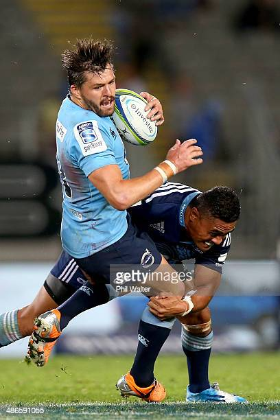 Adam AshleyCooper of the Waratahs is tackled by Francis Saili of the Blues during the round 11 Super Rugby match between the Blues and the Waratahs...