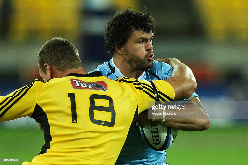 <a gi-track='captionPersonalityLinkClicked' href=/galleries/search?phrase=Adam+Ashley-Cooper&family=editorial&specificpeople=637621 ng-click='$event.stopPropagation()'>Adam Ashley-Cooper</a> of the Waratahs is tackled by James Broadhurst of the Hurricanes during the round eight Super Rugby match between the Hurricanes and the Waratahs at Westpac Stadium on April 6, 2013 in Wellington, New Zealand.