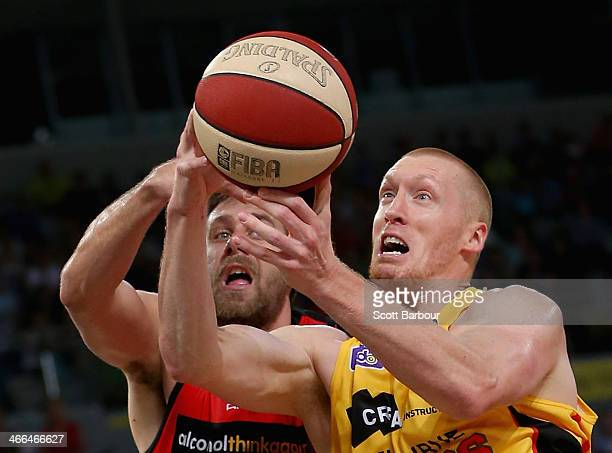 Adam Ballinger of the Tigers and Tom Jervis of the Wildcats compete for the ball during the round 16 NBL match between the Melbourne Tigers and the...