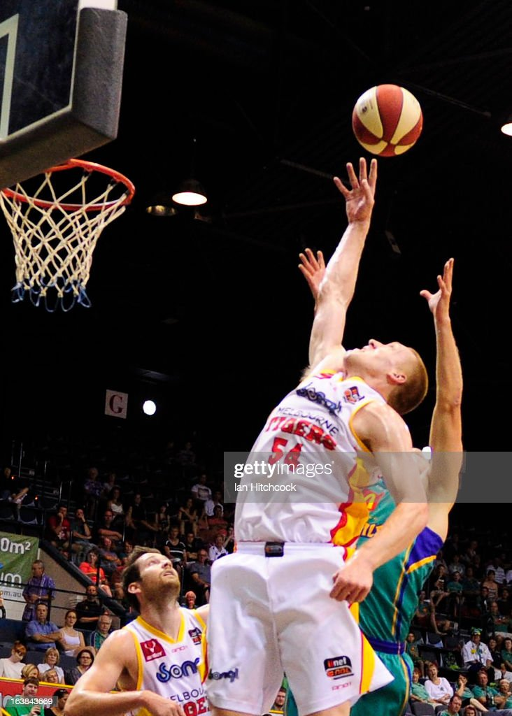 Adam Ballinger of the Tigers attempts to regather a rebound during the round 23 NBL match between the Townsville Crocodiles and the Melbourne Tigers at Townsville Entertainment Centre on March 17, 2013 in Townsville, Australia.