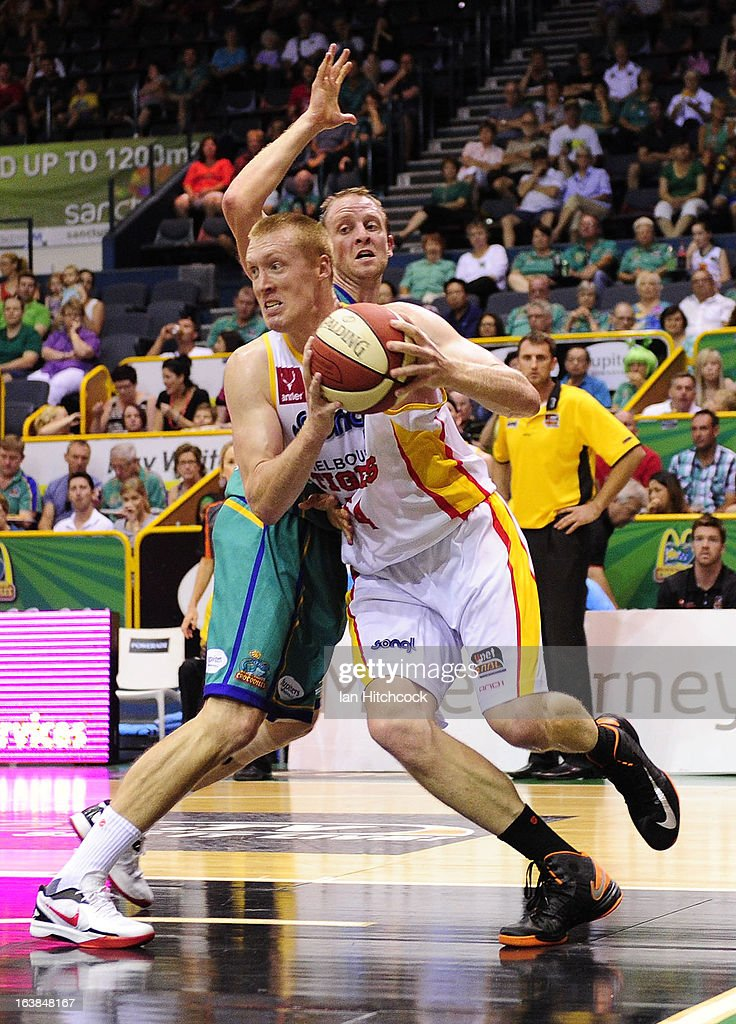 Adam Ballinger of the Tigers drives past Jacob Holmes of the Crocodiles during the round 23 NBL match between the Townsville Crocodiles and the Melbourne Tigers at Townsville Entertainment Centre on March 17, 2013 in Townsville, Australia.