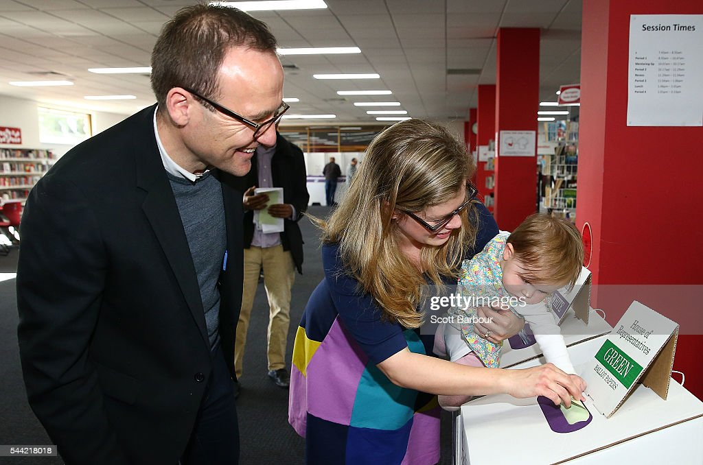 Adam Bandt, Greens Federal Member for Melbourne along with his wife Claudia Bandt and daughter Wren Bandt votes in the national election at a polling station on July 2, 2016 in Melbourne, Australia. Voters head to the polls today to elect the 45th parliament of Australia.