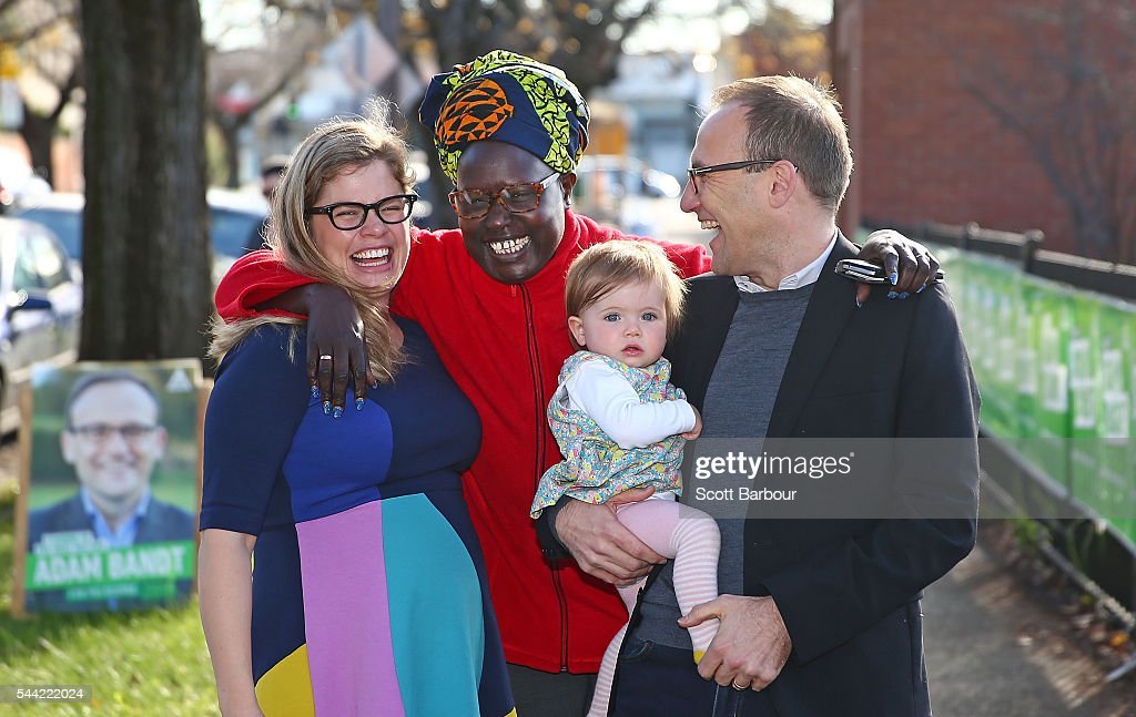 Adam Bandt, Greens Federal Member for Melbourne, his wife Claudia Bandt and daughter Wren Bandt speak to a supporter before voting in the national election at a polling station on July 2, 2016 in Melbourne, Australia. Voters head to the polls today to elect the 45th parliament of Australia.