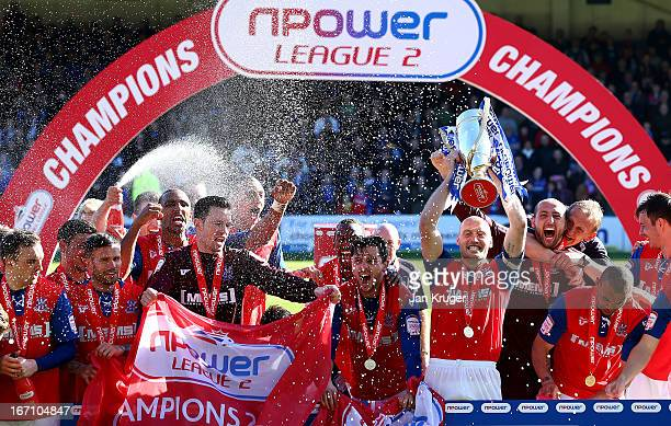 Adam Barrett Captain of Gillingham lifts the trophy after securing promotion during the npower League Two match between Gillingham and AFC Wimbledon...