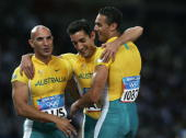 Adam Basil Patrick Johnson and Joshua Roberts of Australia are seen after the men's 4 x 100 metre relay on August 27 2004 during the Athens 2004...