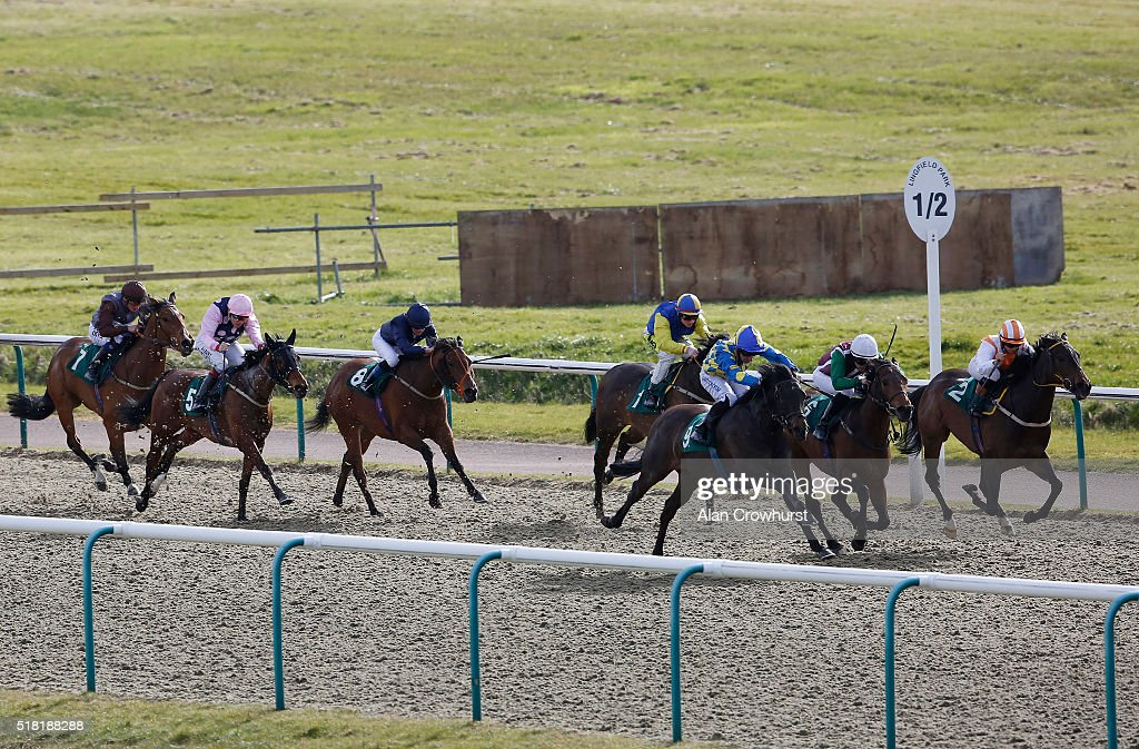 Adam Beschizza riding Music Major (3R) win The Orpheus Centre handicap Stakes at Lingfield racecourse on March 30, 2016 in Lingfield, England.