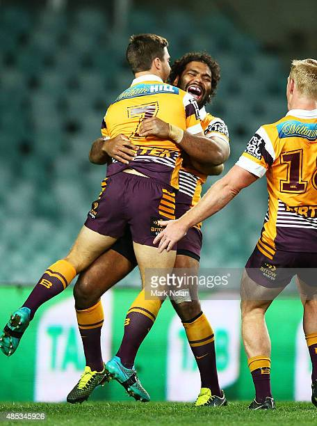 Adam Blair and Ben Hunt of the Broncos celebrate a try by Hunt during the round 25 NRL match between the South Sydney Rabbitohs and the Brisbane...