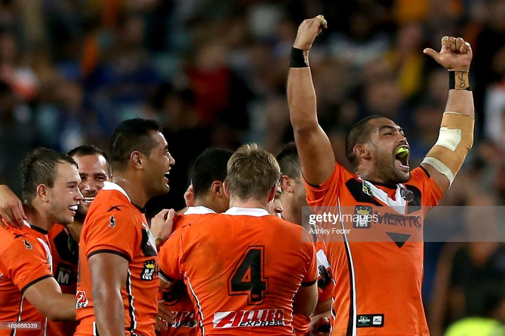 Adam Blair celebrates the win with his Wests Tigers teammates after winning during the round seven NRL match between the Parramatta Eels and the Wests Tigers at ANZ Stadium on April 21, 2014 in Sydney, Australia.