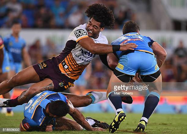 Adam Blair of the Broncos attempts to tackle Greg Bird of the Titans during the round five NRL match between the Gold Coast Titans and the Brisbane...