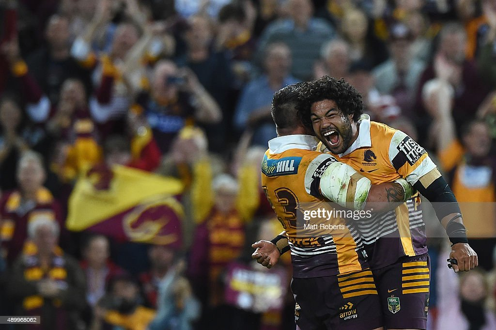 Adam Blair of the Broncos celebrates victory with Corey Parker during the NRL First Preliminary Final match between the Brisbane Broncos and the Sydney Roosters at Suncorp Stadium on September 25, 2015 in Brisbane, Australia.