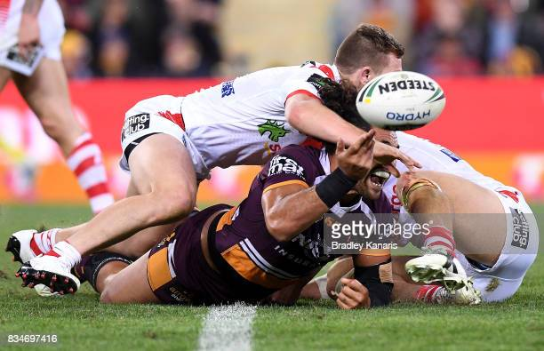 Adam Blair of the Broncos gets a pass away during the round 24 NRL match between the Brisbane Broncos and the St George Illawarra Dragons at Suncorp...