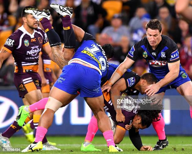 Adam Blair of the Broncos is lifted in the tackle by Danny Fualalo of the Bulldogs during the round 20 NRL match between the Brisbane Broncos and the...