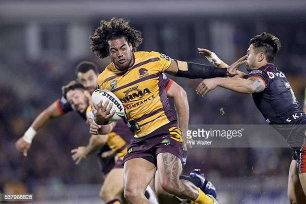 Adam Blair of the Broncos is tackled by Shaun Johnson of the Warriors during the round 13 NRL match between the New Zealand Warriors and the Brisbane...