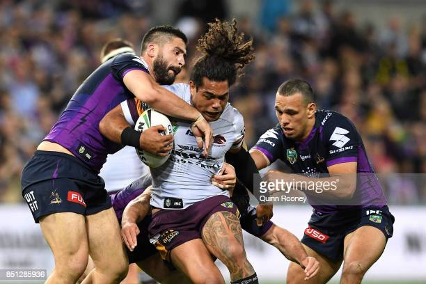 Adam Blair of the Broncos is tackled during the NRL Preliminary Final match between the Melbourne Storm and the Brisbane Broncos at AAMI Park on...