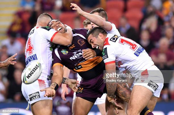 Adam Blair of the Broncos offloads during the round 24 NRL match between the Brisbane Broncos and the St George Illawarra Dragons at Suncorp Stadium...