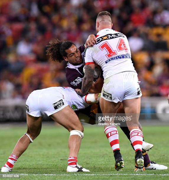 Adam Blair of the Broncos takes on the defence during the round 24 NRL match between the Brisbane Broncos and the St George Illawarra Dragons at...