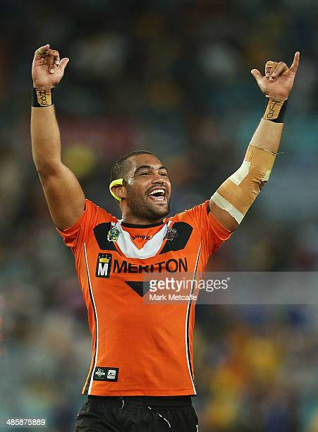 Adam Blair of the Tigers celebrates victory at the end of the round seven NRL match between the Parramatta Eels and the Wests Tigers at ANZ Stadium...