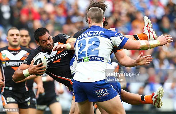 Adam Blair of the Tigers is tackled during the round 19 NRL match between the Wests Tigers and the Canterbury Bulldogs at ANZ Stadium on July 20 2014...