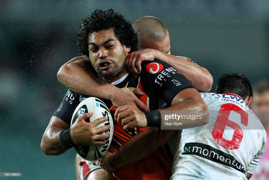 Adam Blair of the Tigers is tackled during the round 23 NRL match between the Wests Tigers and the St George Illawarra Dragons at Allianz Stadium on August 11, 2012 in Sydney, Australia.