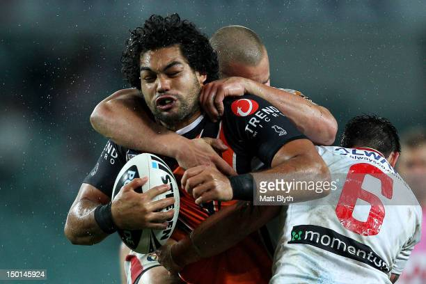 Adam Blair of the Tigers is tackled during the round 23 NRL match between the Wests Tigers and the St George Illawarra Dragons at Allianz Stadium on...