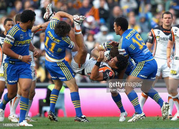 Adam Blair of the Tigers is tackled during the round eight NRL match between the Parramatta Eels and the Wests Tigers at Parramatta Stadium on April...