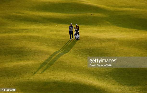 Adam Bland of Australia and his caddie Matthew Butlar wait on the 18th hole during the second round of the 144th Open Championship at The Old Course...