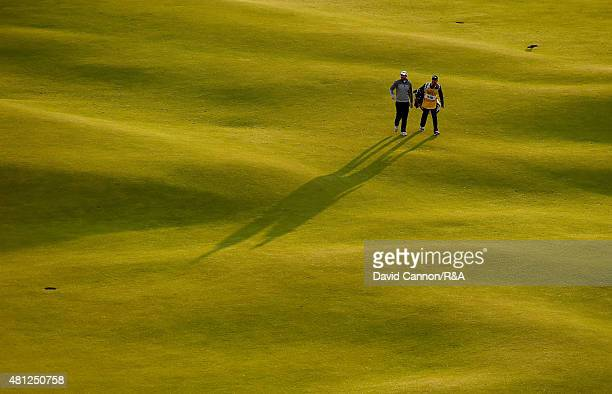 Adam Bland of Australia and his caddie Matthew Butlar walk up the 18th hole during the second round of the 144th Open Championship at The Old Course...