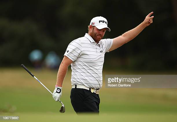 Adam Bland of Australia celebrates his chip shot on the 6th to birdie during round two of the Australian Masters at The Victoria Golf Club on...