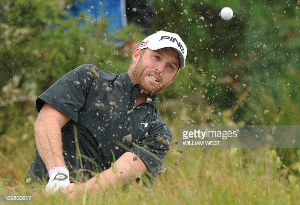 Adam Bland of Australia chips out of a bunker as he leads during the third round of the Australian Masters played at the Victoria Golf Club in...
