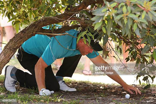 Adam Bland of Australia hits trouble on the 1st hole during day four of the Australian Masters at The Metropolitan Golf Course on November 23 2014 in...