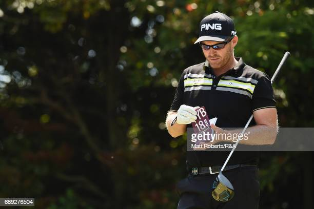 Adam Bland of Australia looks at his yardage book during the final round of Mizuno Open at JFE Setonaikai Golf Club on May 28 2017 in Okayama Japan