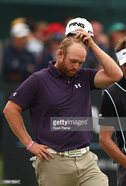 Adam Bland of Australia looks dejected after missing a putt on the 18th green during round four of the Australian Masters at The Victoria Golf Club...