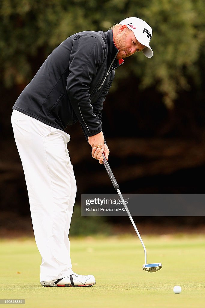 <a gi-track='captionPersonalityLinkClicked' href=/galleries/search?phrase=Adam+Bland&family=editorial&specificpeople=785550 ng-click='$event.stopPropagation()'>Adam Bland</a> of Australia plays a shot on the 9th hole during the Open International Final Qualifying Australasia day one at Kingston Heath Golf Club on January 29, 2013 in Melbourne, Australia.